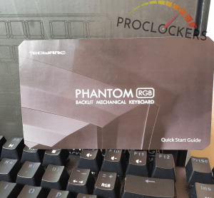 Phantom RGB 87 Keyboard manual in front of Phantom RGB packaging above keyboard